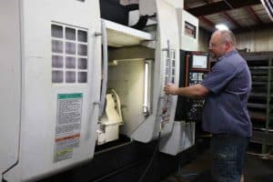 5-axis machining center enhances custom machined parts quality and efficiency